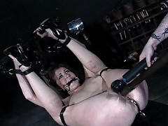 Sabrina Fox is twisted and locked into severe bondage positions.
