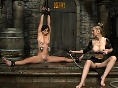 Wenona is tied in the splits and made to fuck a dildo in the tank