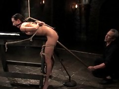 sexy slave bound, hot waxed and sprayed with water